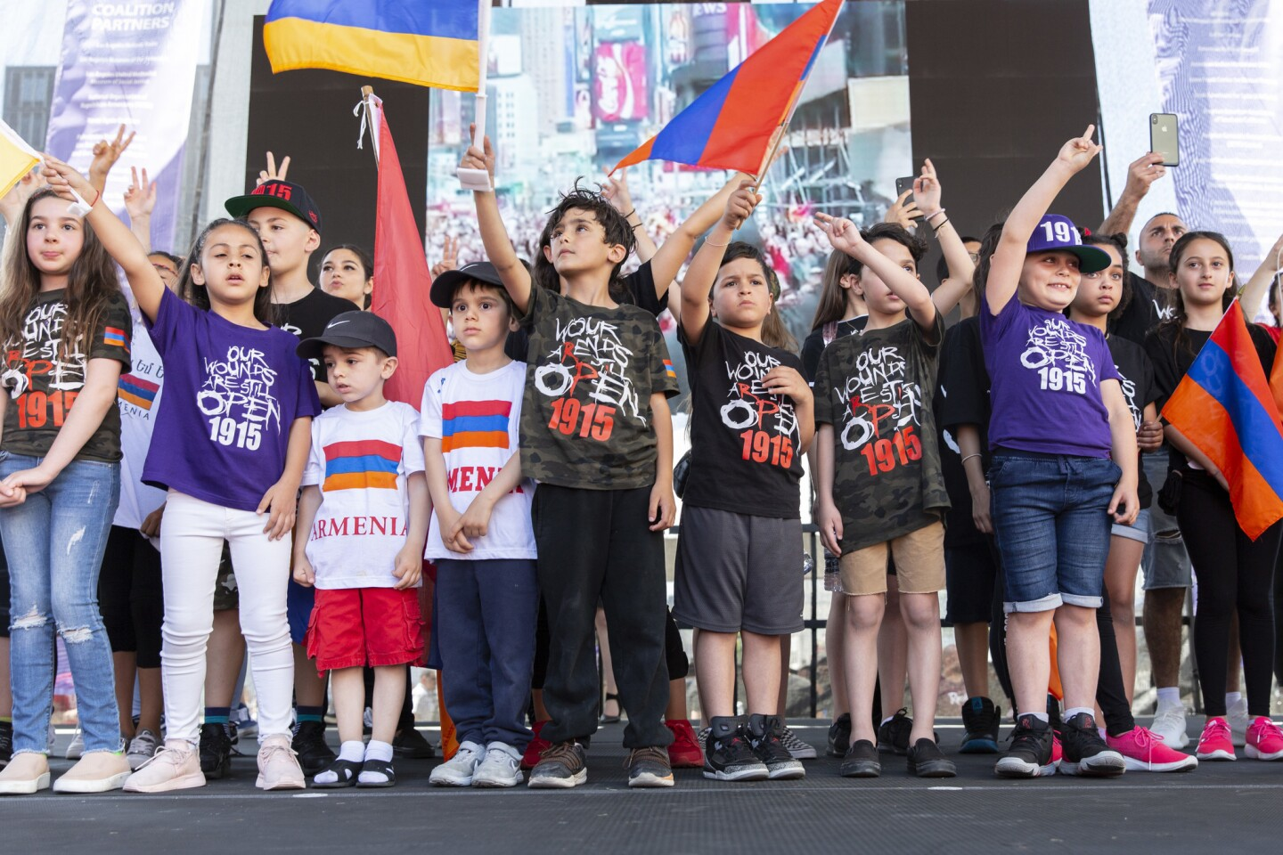 Children participate in a rally outside the Turkish Consulate in Los Angeles to remember the Armenian genocide of more than a century ago.