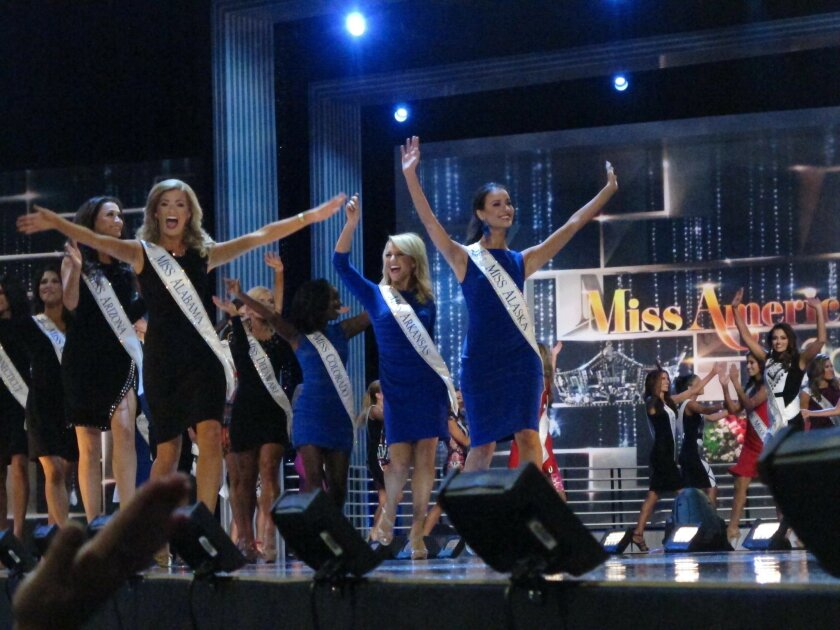 Contestants take the stage in the third and final night of preliminary competition in the Miss America pageant in Atlantic City, N.J. on Thursday Sept. 8, 2016. The new Miss America will be crowned Sunday. (AP Photo/Wayne Parry)