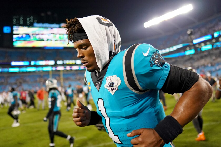 Carolina Panthers quarterback Cam Newton leaves the field following a 20-14 loss to the Tampa Bay Buccaneers on Thursday in Charlotte, N.C.