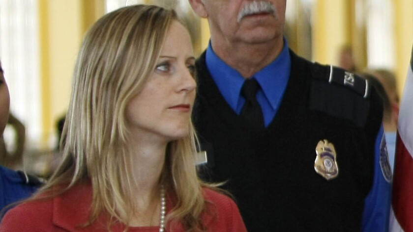 Kathy Kraninger, President Trump's nominee to head the Consumer Financial Protection Bureau, is shown at a 2008 news conference when she was a deputy assistant secretary at the Department of Homeland Security.