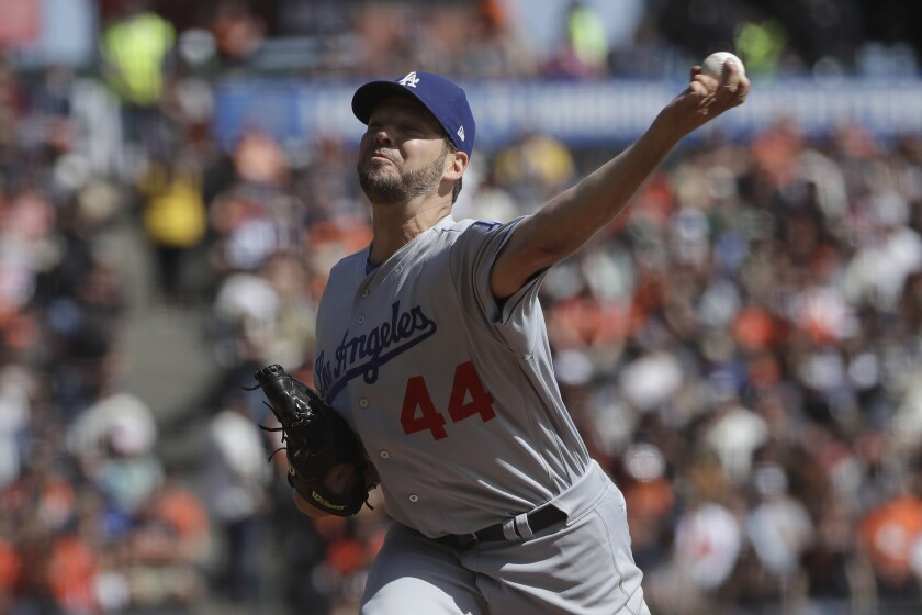 Dodgers pitcher Rich Hill delivers against the Giants.