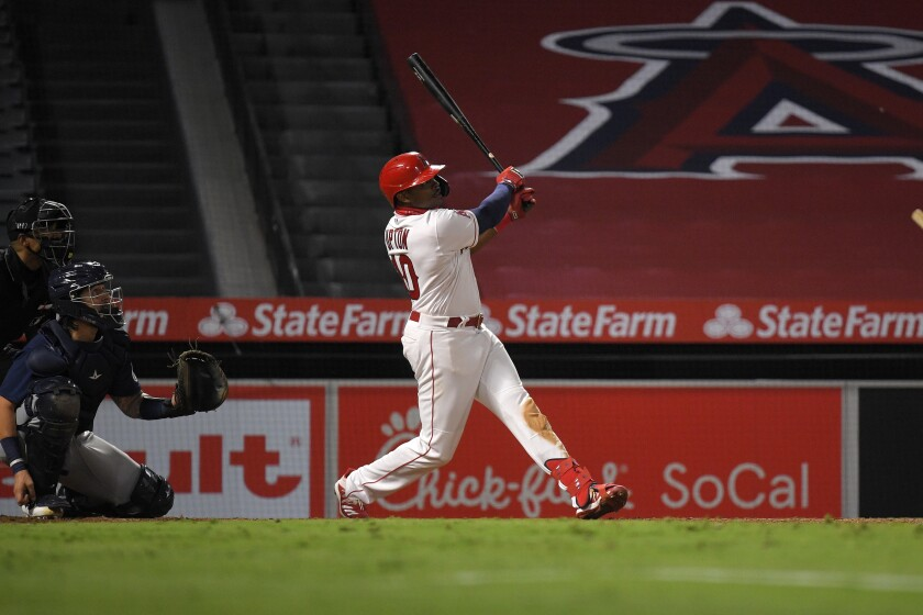 Angels' Justin Upton hits a solo home run during the sixth inning on July 29 at Angel Stadium.
