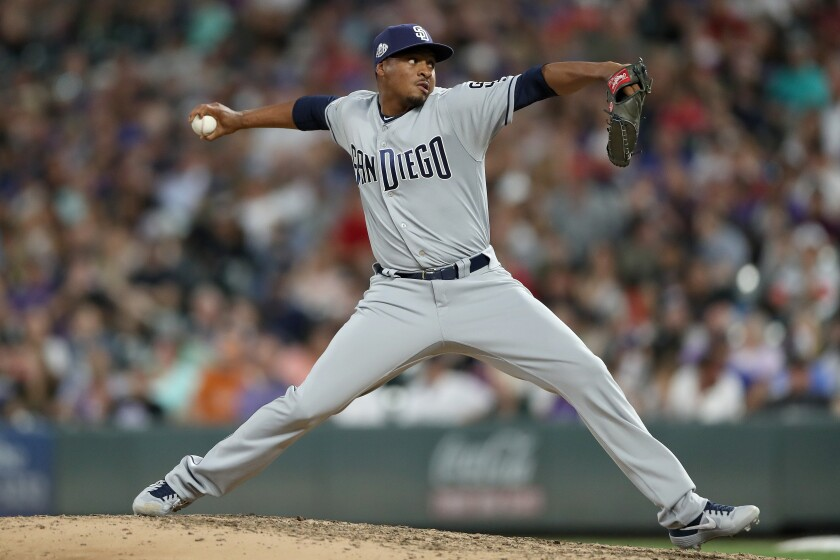 Padres reliever Luis Perdomo throws in the sixth inning against the Rockies on Thursday at Coors Field.