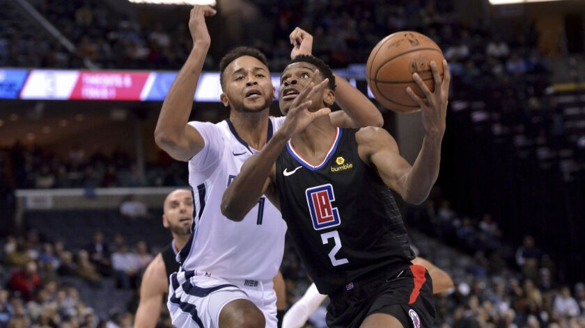 Clippers guard Shai Gilgeous-Alexander (2) drives against Memphis Grizzlies forward Kyle Anderson (1) in the first half on Wednesday.
