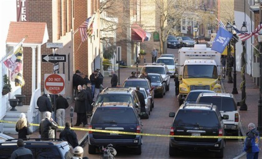 Frances Street in Annapolis, Md., is blocked off as officials investigate a suspicious package in the Jeffery Building, Thursday, Jan. 6, 2011. Two packages sent to state government buildings 20 miles apart released smoke and odors when they were opened Thursday, but no one was seriously injured, officials said. (AP Photo/Susan Walsh)