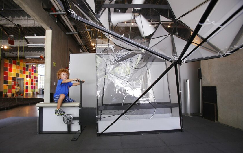 Daniel Ashlock, 6, of San Marcos, powers up Wind Vessel, a new installation by Miki Iwasaki at the New Children's Museum.