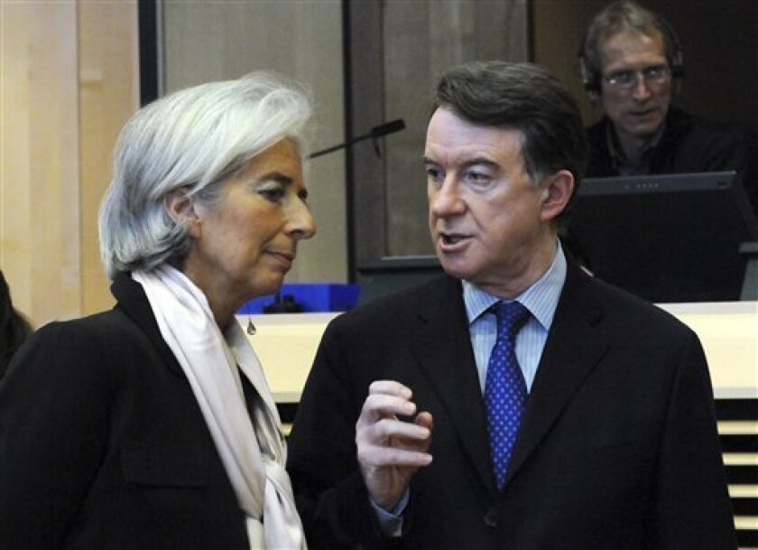 France's Minister for Economy and Industry Christine Lagarde, left, and UK State Secretary for Business, Enterprise and Regulatory Reforms Peter Mandelson, right, share a few words  prior to the start of a High Level Group Cars Ministerial meeting on Automotive Industry held at the European Union C