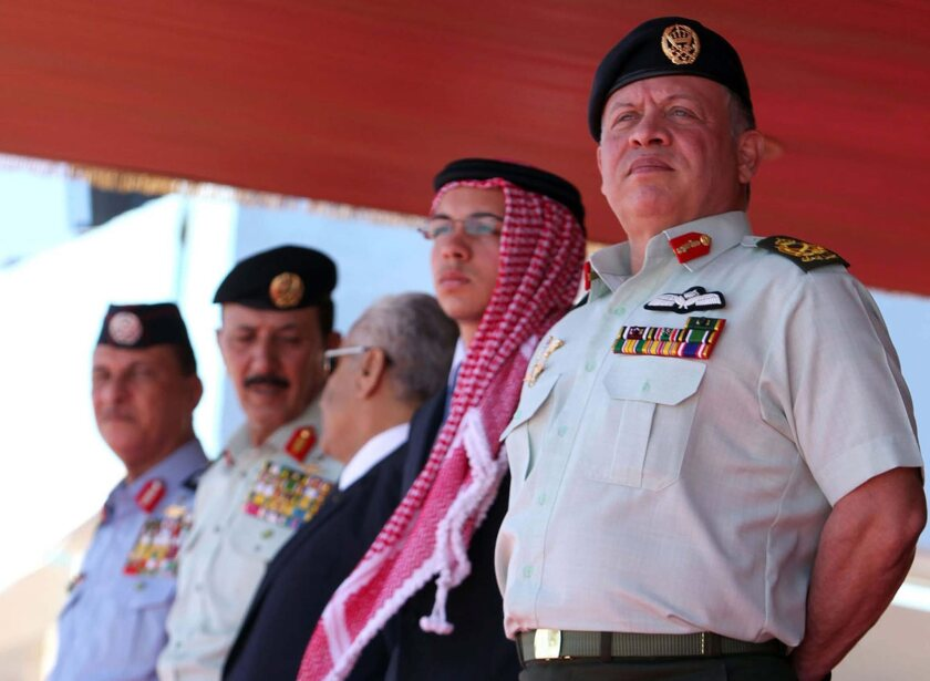 Jordanian King Abdullah II, right, and his son Crown Prince Hussein, second from right, attend a military graduation ceremony Sunday in Karak, Jordan.