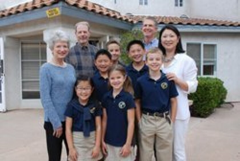 Gail Kendall, Chuck Kendall, and Bill Weber join Jean Kim, Head of School, and students visiting the new campus of The Cambridge School.