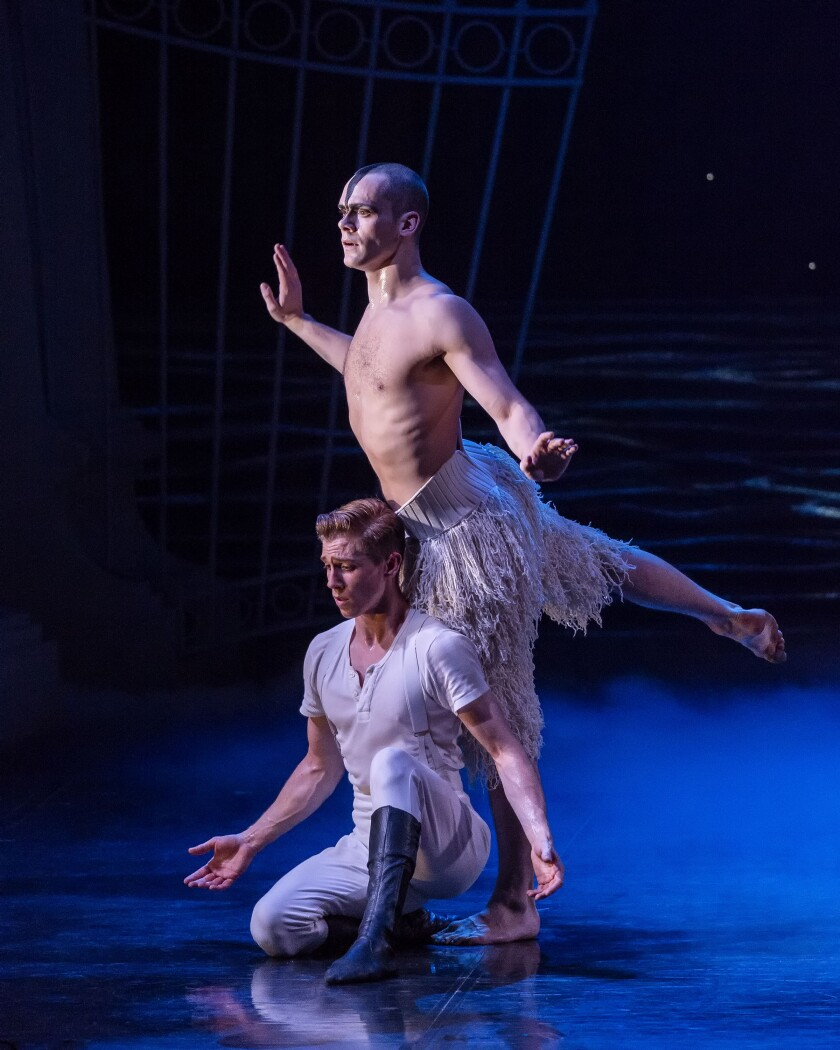 The Prince (Andrew Monaghan, kneeling) and Will Bozier as the Swan.