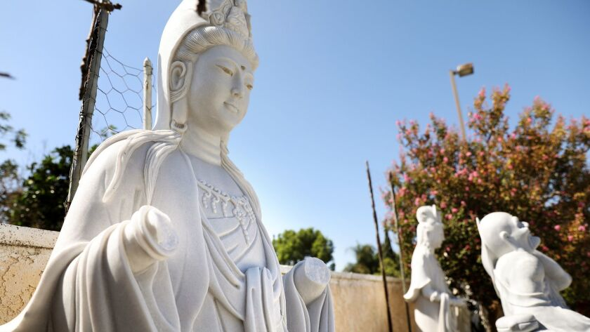 This statue at Huong Tich Temple in Santa Ana was among those vandalized.