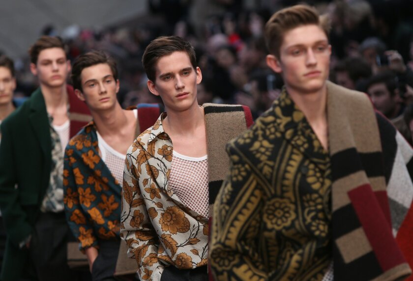 Models wear designs created by Burberry Prorsum during London Collections for Men Autumn/Winter 2014 fashion show, at the Royal Albert Memorial in west London, Wednesday, Jan. 8, 2014. (Photo by Joel Ryan/Invision/AP)