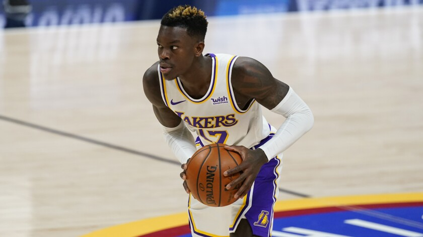 Lakers guard Dennis Schroder in action against the Nuggets.