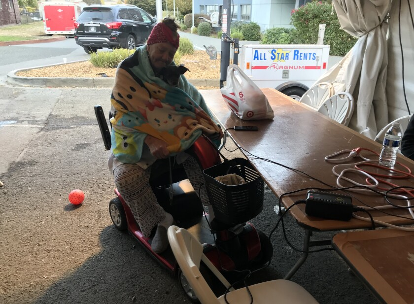 Wilma Mears charges her electric scooter