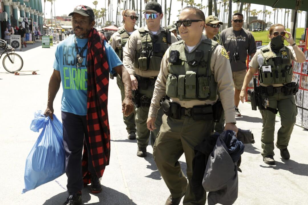 Sheriff's deputies escort Leland Robinson.