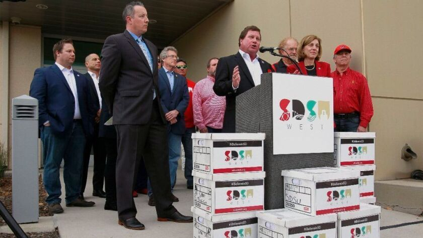 SAN DIEGO, January 16, 2018 | Friends of SDSU steering committee member Fred Pierce speaks before he and other supporters submit boxes of more than 106,000 signatures at the San Diego County Registrar of Voters.