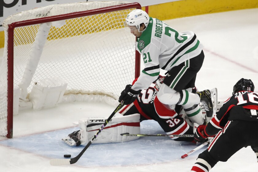 Dallas Stars left wing Jason Robertson (21) scores a goal past Chicago Blackhawks goaltender Kevin Lankinen (32) during the second period of an NHL hockey game Thursday, April 8, 2021, in Chicago. (AP Photo/Jeff Haynes)