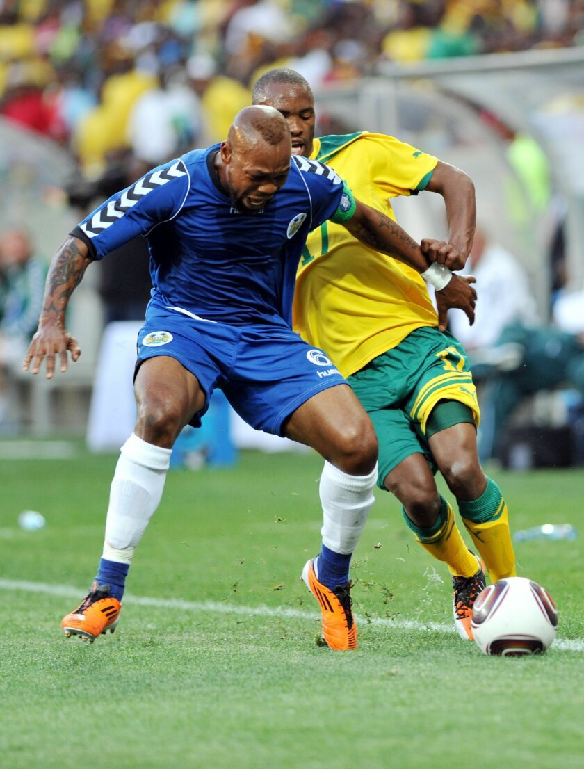 FILE - This is a Saturday Oct. 8 2011 file photo of  Sierra Leone's Ibrahim Kargbo, right,as he  challenges South Africa's Bernard Parker during their Africa Cup Of Nations qualifier in Nelspruit, South Africa. The Royal Netherlands Football Association said Monday Feb. 15, 20-16  that its integrit