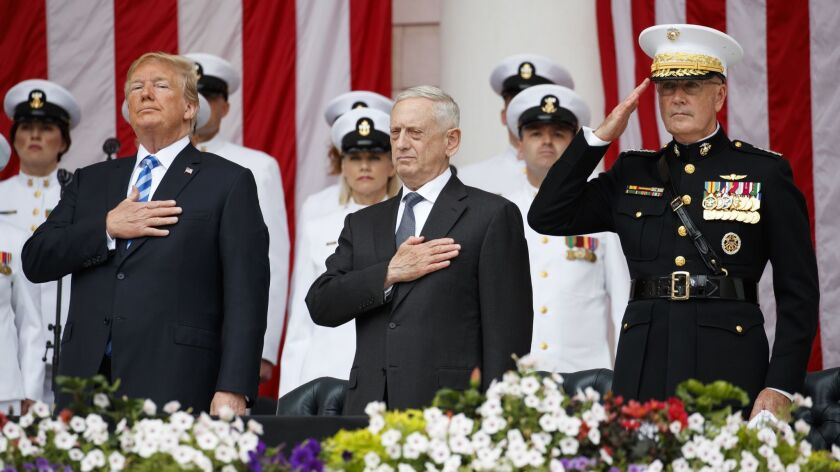 From left, President Trump, Secretary of Defense Jim Mattis and Chairman of the Joint Chiefs of Staff Gen. Joseph Dunford stand for taps during a Memorial Day ceremony.