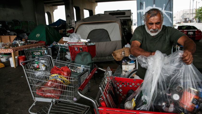 Residents of a homeless encampment under the 1st street bridge go about their daily lives in Los Angeles, Calif., on May 31.
