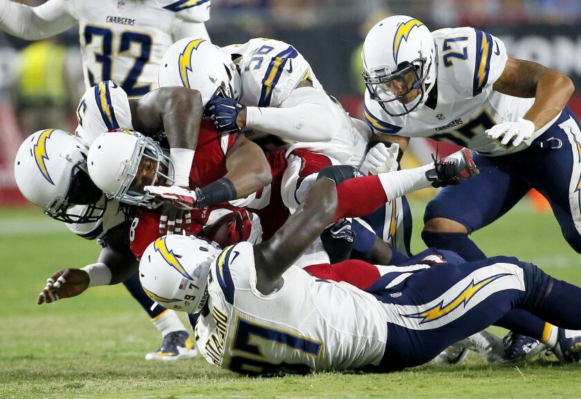 Arizona Cardinals running back Andre Ellington (38) is hit by San Diego Chargers outside linebacker Jeremiah Attaochu (97), outside linebacker Melvin Ingram (54), inside linebacker Donald Butler (56) and defensive back Jimmy Wilson (27) .