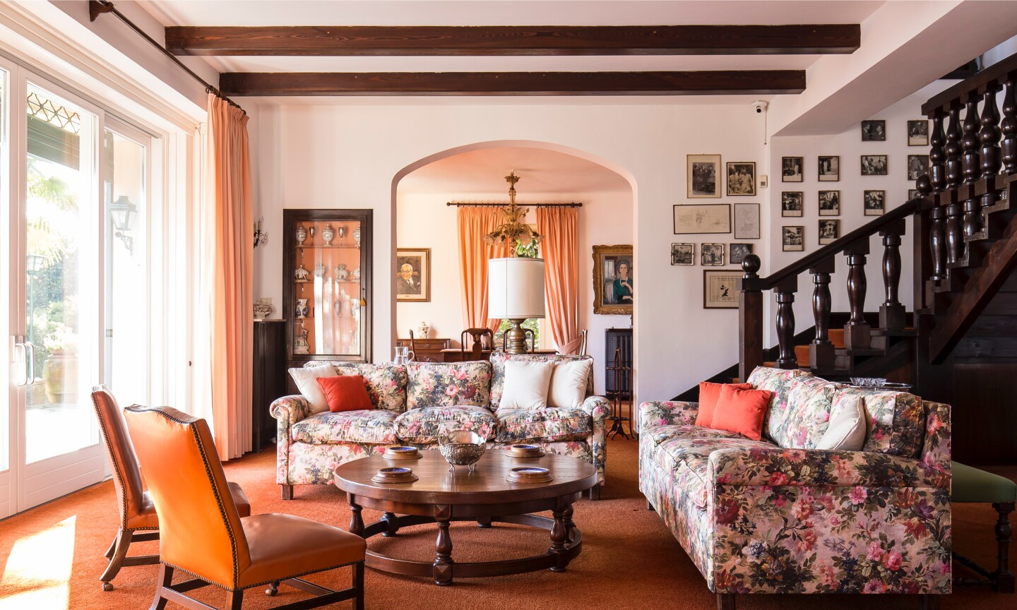 Overlooking Lake Maggiore, the pink stucco home holds 20 bedrooms and 12 bathrooms in more than 15,000 square feet.