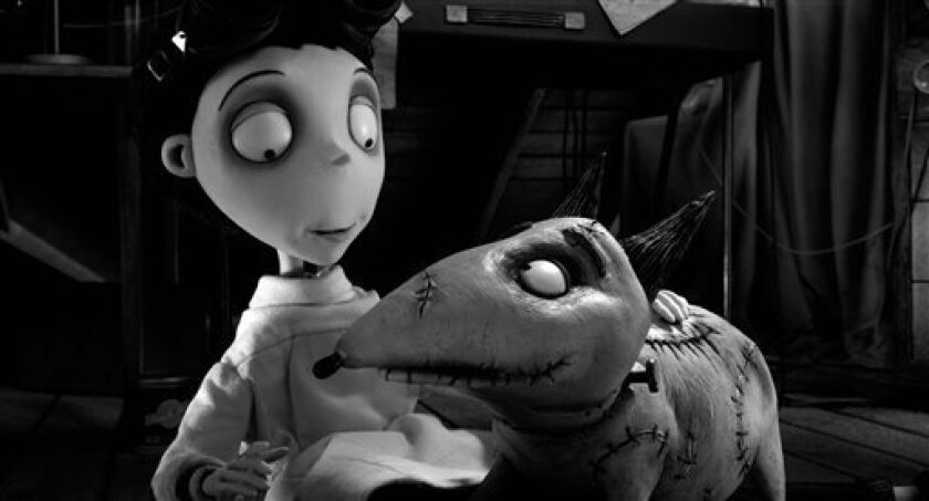"""This film image released by Disney shows Victor Frankenstein, voiced by Charlie Tahan, with Sparky, in a scene from """"Frankenweenie."""" (AP Photo/Disney)"""
