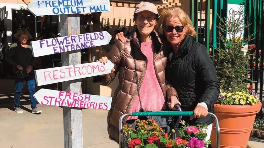 Senior Joyce and her caregiver Sarah at a local flower nursery