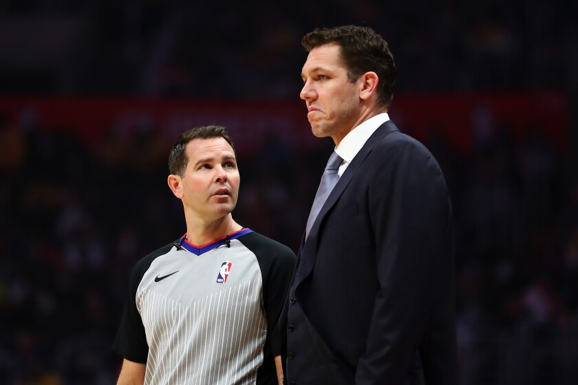 Sacramento coach Luke Walton, shown during a game while with the Lakers, successfully challenged an official's call Saturday during a preseason game.