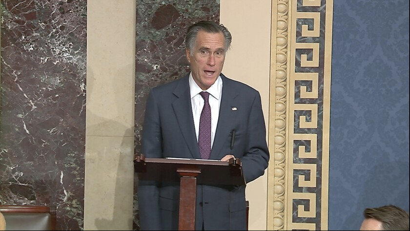 In this image from video, Sen. Mitt Romney, R-Utah, speaks as the Senate reconvenes to debate the objection to confirm the Electoral College Vote from Arizona, after protesters stormed into the U.S. Capitol on Wednesday, Jan. 6, 2021. (Senate Television via AP)