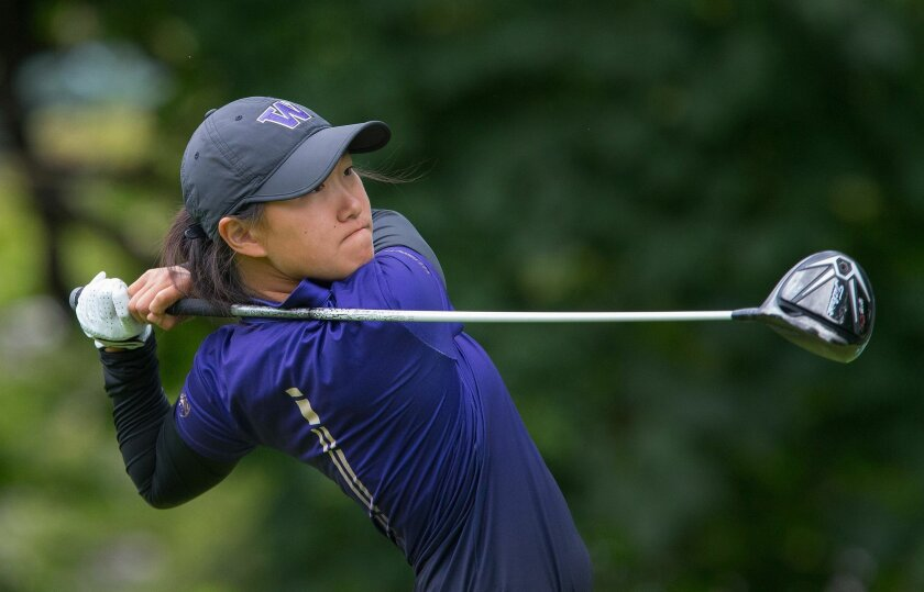 Washington's Sarah Rhee watches her drive on the par-5 fifth hole during the final round of the NCAA Division I women's golf championship, at Eugene Country Club in Eugene, Ore., Wednesday, May 25, 2016. (Brian Davies/The Register-Guard via AP)