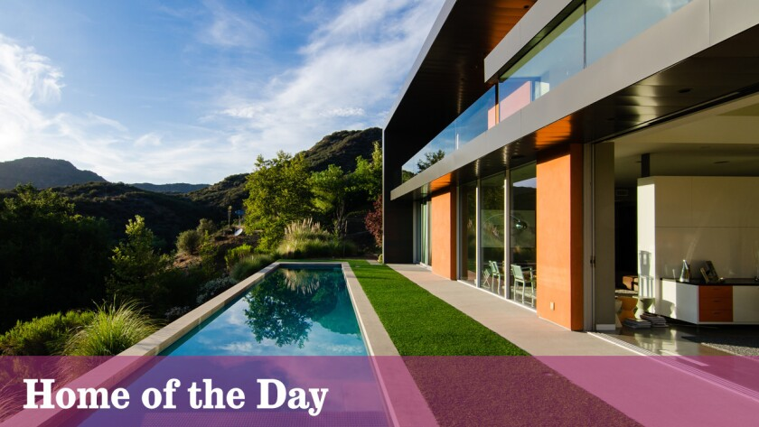 Set on about three acres in Calabasas, this modern-style home featurs walls of glass, open-area spaces and sprawling mountain views.