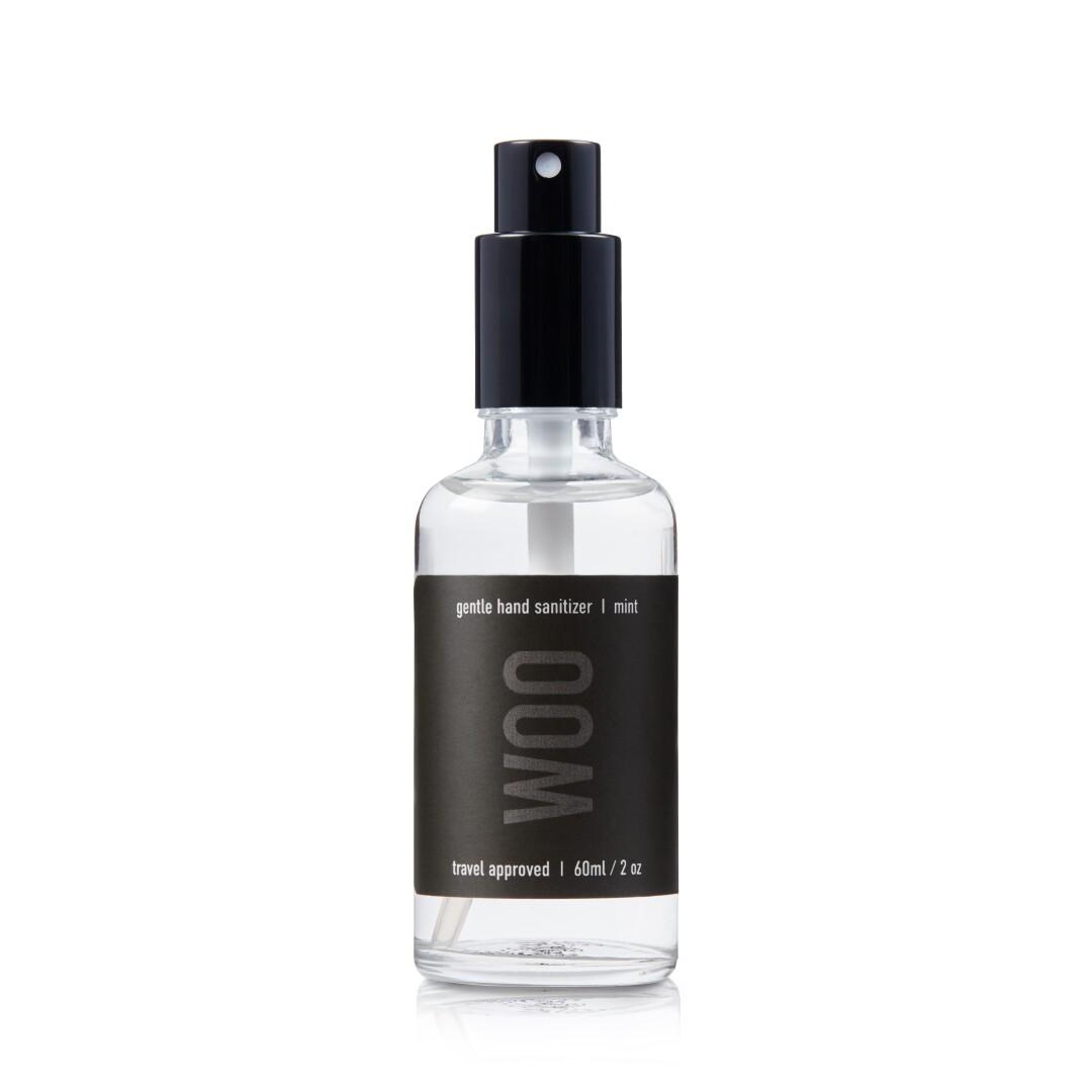 A Woo Skin Essentials hand sanitizer.