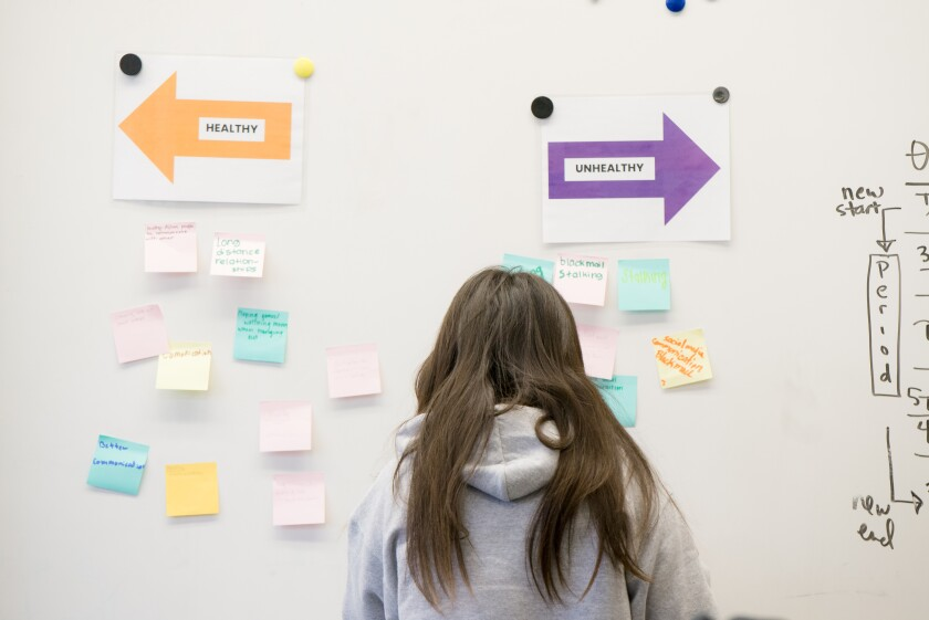 A woman participates in a Human Options' workshop.