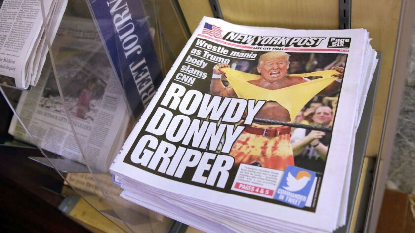 Copies of the New York Post with an illustration of President Donald Trump as a professional wrestler on the front page in New York City on July 3.