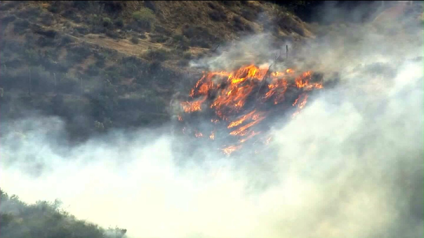 Los Angeles County firefighters are battling a brush fire in the Santa Clarita area Friday morning. The blaze, which broke out near Newhall Ranch Road and Copper Hill Drive around 7:15 a.m., has scorched between eight and 10 acres.