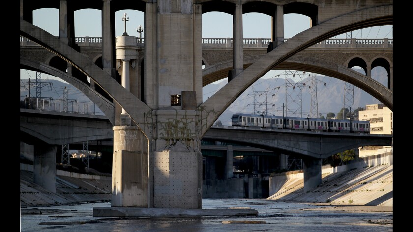 A Metro Line train crosses over the L.A. River.