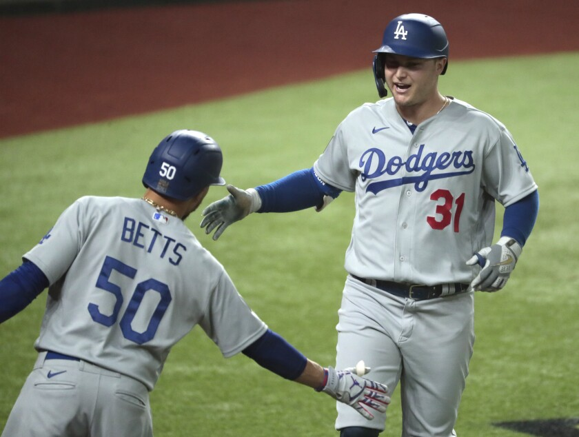 Joc Pederson crosses home plate after homering in the second inning of Game 5.