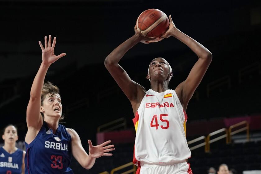 Spain's Astou Ndour (45) shoots past Serbia's Krajisnik (33) during a women's basketball game at the 2020 Summer Olympics, Thursday, July 29, 2021, in Saitama, Japan. (AP Photo/Eric Gay)