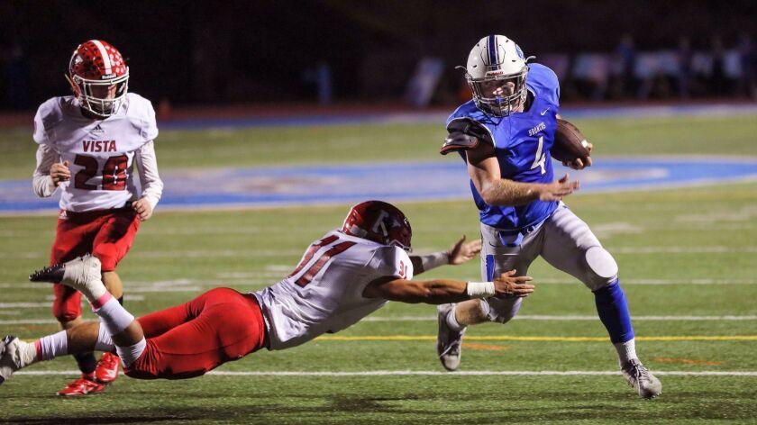 Rancho Bernardo's Jack Gaylord avoids a diving tackle attempt by Vista's Erik Courtney.