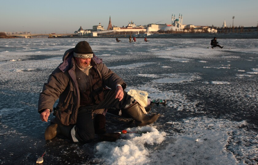 Fishermen on the ice of the Rank Cohanks in Kazan, Russia