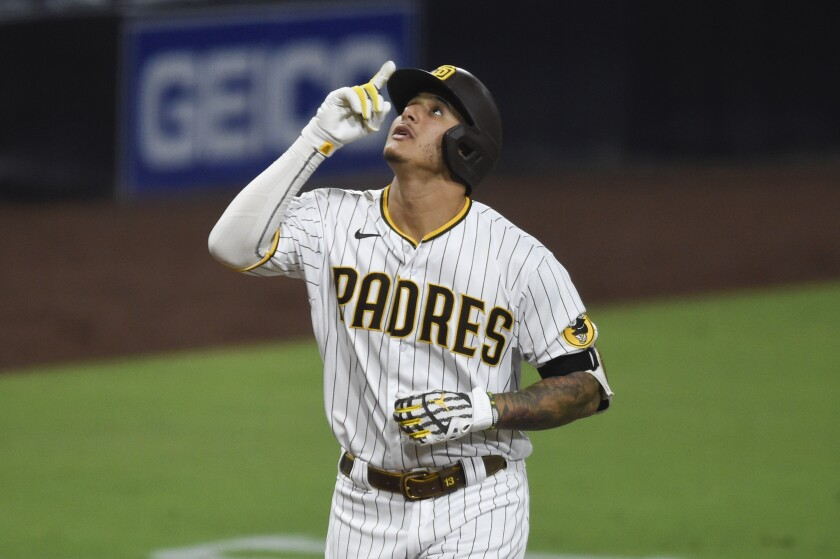 The Padres' Manny Machado points skyward after hitting a two-run home run