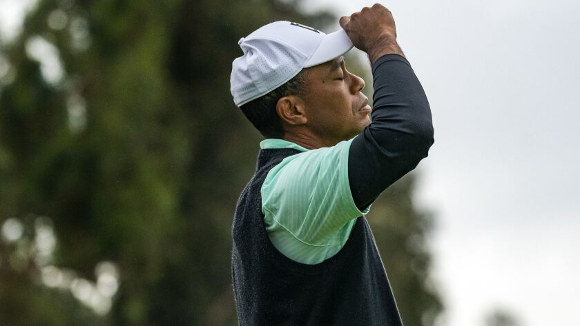 PACIFIC PALISADES, CA - FEBRUARY 15, 2019: Tiger Woods reacts after missing a birdie putt the 17th g