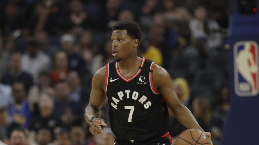 Toronto Raptors guard Kyle Lowry dribbles against the Golden State Warriors in San Francisco on March 5.