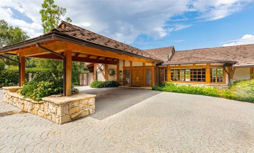Spanning two parcels on two acres, the Fryman Estates property holds a 7,000-square-foot home, swimming pool, spa and tennis court.