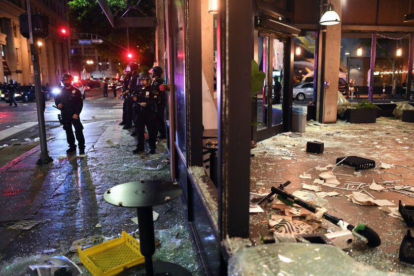 A Starbucks is looted along Spring St. in Downtown Los Angeles Friday night.