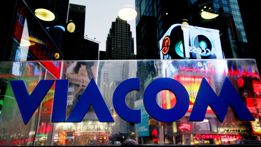 ** FILE ** Times Square is reflected in the Viacom logo on it's headquarters in a New York file phot