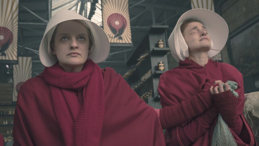"""Elisabeth Moss, left, stars in """"The Handmaid's Tale,"""" an Emmy-winning drama series based on the best-selling novel by Margaret Atwood."""