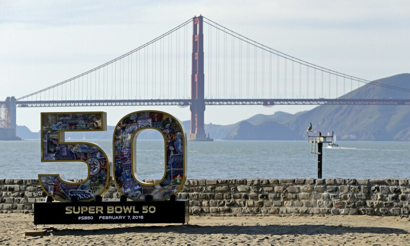 A Super Bowl 50 sign rests on the beach near the Golden Gate Bridge. The FBI and more than 30 other law enforcement agencies rescued seven teens in a Super Bowl sex-trafficking sweep.
