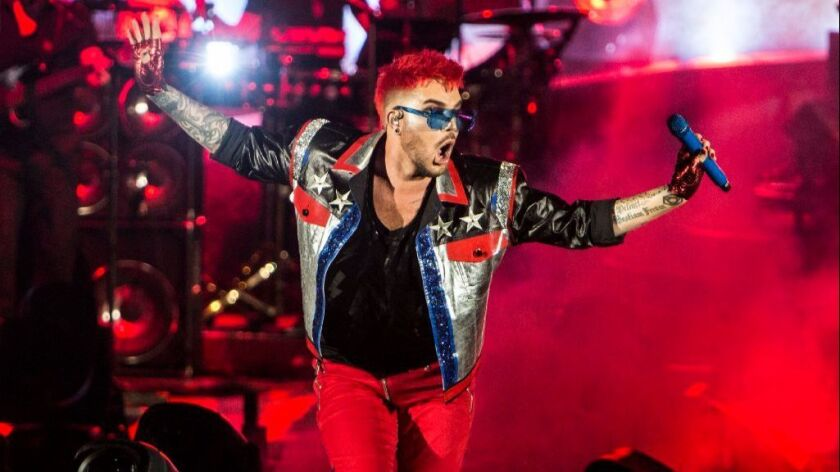 San Diego-bred vocal dynamo Adam Lambert is shown on stage with Queen.